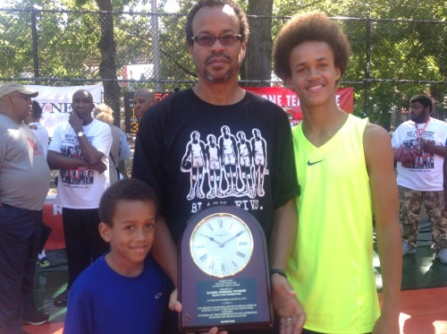 Claude Johnson at Rucker Park with sons