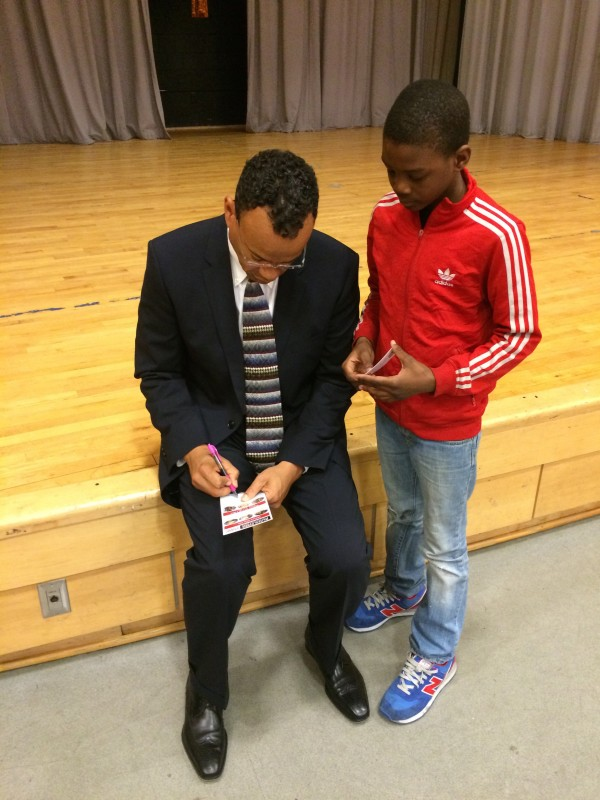Claude Johnson visits schools in Brooklyn, New York.