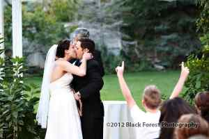 Best wedding kiss by bride and groom at the Briarhurst