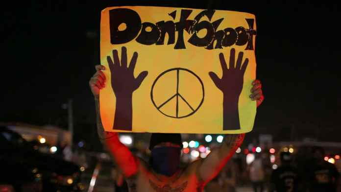 Racist Police Violence: Hands Up - Don't Shoot