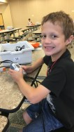 A student at the Academy spends time learning about robotics!