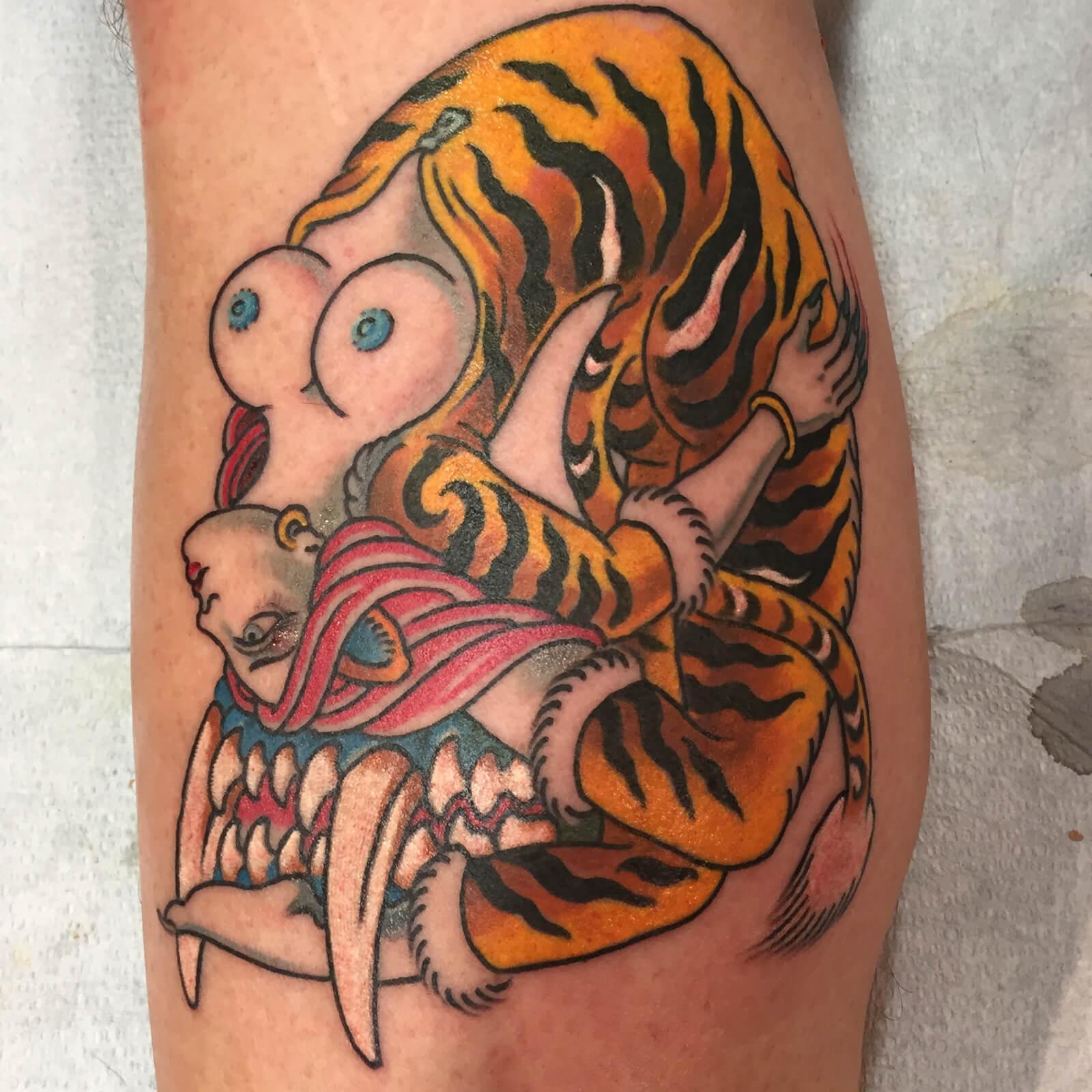Lango-Oliveira-black-heart-tattoo-8