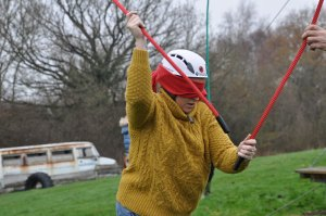 low level ropes course - woman blindfolded challenge