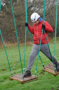 low level ropes course teenager footing steps crossing