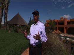 Eugene Jackson stands in front of his newly built 34,000 square foot home near Durban
