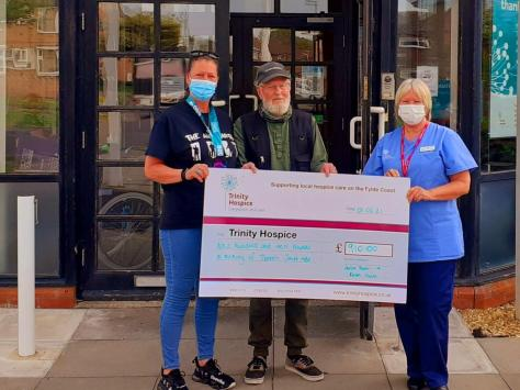 Julie Dean and her dad Peter Smith present Trinity Hospice with £910, after Julie ran 500km in memory of her mum Doreen Smith MBE. Photo: Julie Dean