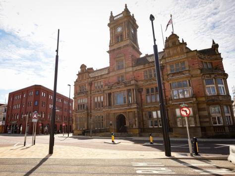Town hall shake up
