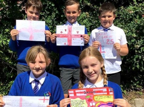 Year Five pupils Ben, Jaxson, Oliver, Lily and Ella with their letters of support to England players who were racially abused after the Euro 2020 final.