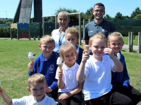 Pupils and teachers with Lewis Smillie from Vision for Education, which funded the ice cream van, enjoying ice creams. Pic: Fylde Coast Academy Trust.