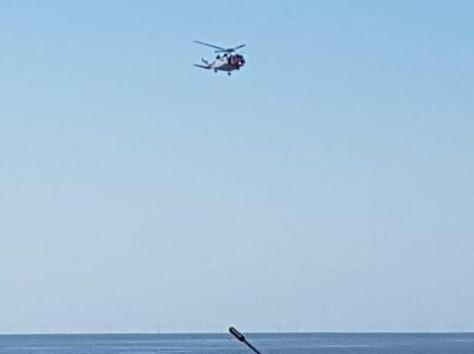 A person was rushed to hospital after being rescued from the sea near North Pier. (Credit: HM Coastguard Fleetwood)