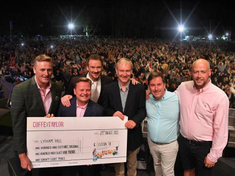 The money was presented to the Hall by Cuffe and Taylor on stage at the Russell Watson concert