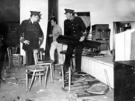 Winter Gardens staff clear up the aftermath of the Rolling Stones riot. A grand piano was reduced to matchwood