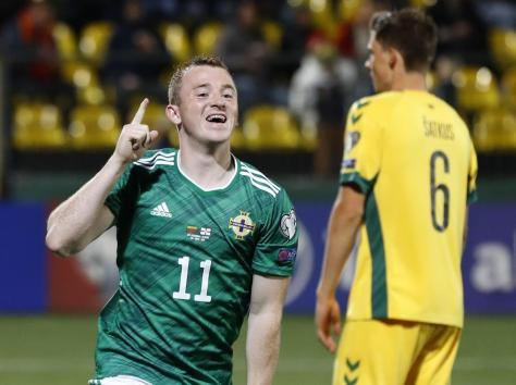 Lavery celebrates scoring his first goal for Northern Ireland. Picture: PA