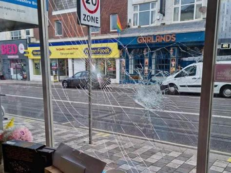 Damage caused to the charity shop window