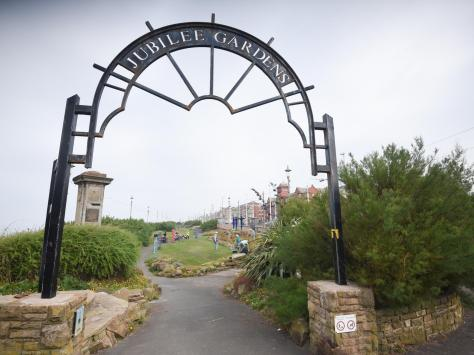 The wrought iron gates of Jubilee Gardens in North Shore, where the dedicated Friends group are looking for more volunteers to join them