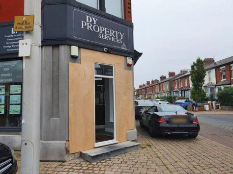 The doorway at DY Property Services in Blackpool has been boarded after a car smashed into the building.