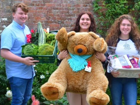 Meet and Greet team members Michael Daly, Charlotte Mellors and Liberty Doyle with some of the raffle prizes