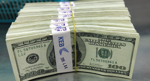 101213_money_stacks_reuters_328