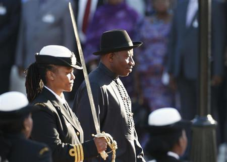 Nigerian President Jonathan inspects the guard of honour outside the Parliament in Cape Town