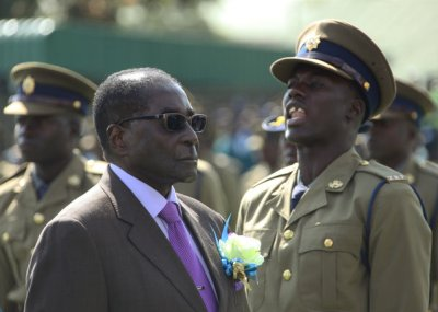 Zimbabwean President Robert Mugabe inspects an honor guard of police officers Thursday in Harare, the country's capital. (Tsvangirayi Mukwazhi / Associated Press / June 13, 2013)