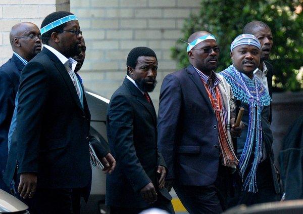 King Buyelekhaya Dalindyebo, center, flanked by tribal chiefs, arrives to visit former South African President Nelson Mandela at a Pretoria hospital. (Alexander Joe / AFP/ Getty Images / July 9, 2013)