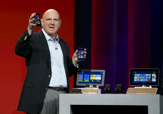 Microsoft CEO Steve Ballmer shows off smartphones running the Windows Phone platform at the Consumer Electronics Show on Jan. 7, 2013. (Courtesy of Bloomberg)