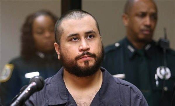 In this Tuesday, Nov. 19,  2013, file photo, George Zimmerman, acquitted in the high-profile killing of unarmed black teenager Trayvon Martin, listens in court, in Sanford, Fla., during his hearing on charges including aggravated assault stemming from a fight with his girlfriend. Zimmerman is asking a judge to change the terms of his bond so he can have contact with his girlfriend. Zimmerman on Monday, Dec. 9, 2013, filed an affidavit from his girlfriend that says she doesn't want him charged with aggravated assault, battery and criminal mischief. (AP Photo/Orlando Sentinel, Joe Burbank, Pool, File)