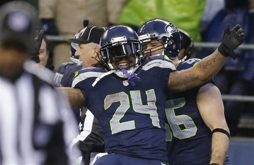 Seattle Seahawks running back Marshawn Lynch celebrates after running for a 31-yard touchdown against the New Orleans Saints during the fourth quarter of an NFC divisional playoff NFL football game in Seattle, Saturday, Jan. 11, 2014. (AP Photo/Ted S. Warren)