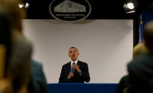 After delivering a speech about the National Security Agency (NSA) surveillance, President Barack Obama speaks in a overflow area at the Justice Department in Washington, Friday, Jan. 17, 2014. (AP Photo/Carolyn Kaster)