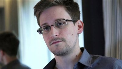 This photo provided by The Guardian Newspaper in London shows Edward Snowden, who worked as a contract employee at the National Security Agency, on Sunday, June 9, 2013, in Hong Kong. (AP Photo/The Guardian)