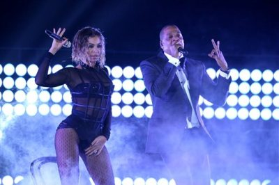 "Beyonce, left, and Jay-Z perform ""Drunk in Love"" at the 56th annual Grammy Awards at Staples Center on Sunday, Jan. 26, 2014, in Los Angeles. (Matt Sayles/Invision/AP)"