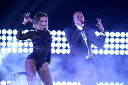 """Beyonce, left, and Jay-Z perform """"Drunk in Love"""" at the 56th annual Grammy Awards at Staples Center on Sunday, Jan. 26, 2014, in Los Angeles. (Photo by Matt Sayles/Invision/AP)"""