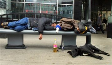 In this Sept. 2005 file photo, men sleep after drinking on a bench in downtown Moscow. (AP Photo/Alexei Sazonov, File)