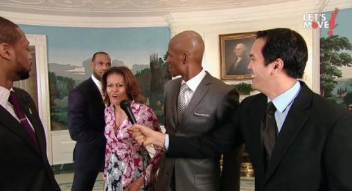 First Lady Michelle Obama, along with Miami Heat forward LeBron James, videobombs Heat players Dwyane Wade, Ray Allen and head coach Erik Spoelstra in Let's Move campaign video (Courtesy of YouTube)