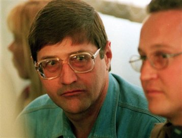 This file photo taken Sept. 14, 1998, shows police death squad leader, Eugene de Kock, who was sentenced to two life terms and more than 200 years, after a killing spree that cost dozens of lives, at an amnesty hearing of the Truth and Reconcilliation Commision (TRC) in Pretoria, South Africa. (AP Photo/Denis Farrell, File)