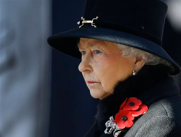 In this Nov. 10, 2013 file photo, Britain's Queen Elizabeth II listens during the service of remembrance at the Cenotaph in Whitehall, London. (AP Photo/Kirsty Wigglesworth, File)