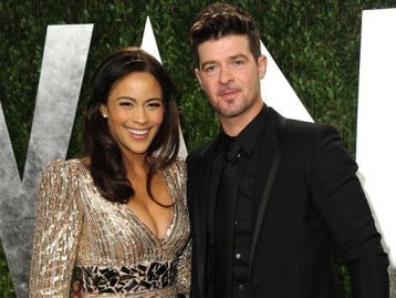 In this Feb. 24, 2013 file photo, Paula Patton and Robin Thicke arrive at the 2013 Vanity Fair Oscars Viewing and After Party at the Sunset Plaza Hotel in West Hollywood, Calif. (Photo by Jordan Strauss/Invision/AP, File)