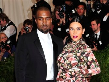"""In this May 6, 2013 file photo, Kanye West and Kim Kardashian attends The Metropolitan Museum of Art's Costume Institute benefit celebrating """"PUNK: Chaos to Couture"""" in New York. A Los Angeles judge on Tuesday March 18, 2014, rejected a motion to dismiss a case filed by Kardashian and West against Chad Hurley, the co-founder of YouTube who posted video of their engagement on his new video-sharing website. (Photo by Charles Sykes/Invision/AP, File)"""