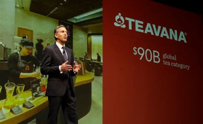 Howard Schultz, chairman and CEO of Starbucks Coffee Company, talks about Starbucks' Teavana tea products, Wednesday, March 19, 2014, at the company's annual shareholders meeting in Seattle. (AP Photo/Ted S. Warren)