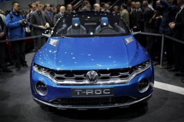 The new Volkswagen T-Roc, urban SUV concept car is introduced during a preview show of Volkswagen Group, as part of the 84th Geneva International Motor Show, Switzerland, Monday, March 3, 2014. The Motor Show will open its gates to the public from March 6 to 16. (AP Photo/Laurent Cipriani)