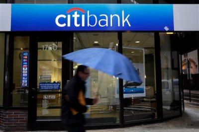 In this Jan. 14, 2014 file photo, a person walks past a Citibank location in Philadelphia. (AP Photo/Matt Rourke, File)
