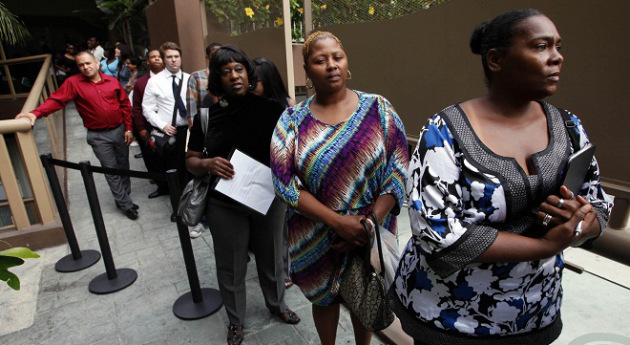 In this Friday, Aug. 17, 2012 file photo, Sheila Bird, right, waits in line for employment interviews at a job fair at City Target in Los Angeles. (AP Photo/Nick Ut, File)