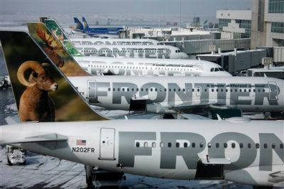 In this Feb. 22, 2010 file photo, Frontier Airlines jetliners sit stacked up at gates along the A concourse at Denver International Airport. (AP Photo/David Zalubowski, File)
