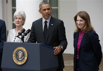 President Barack Obama, flanked by outgoing Health and Human Services Secretary Kathleen Sebelius, left, and his nominee to be her replacement, Budget Director Sylvia Mathews Burwell, speaks in the Rose Garden of the White House in Washington, Friday, April 11, 2014. The moves come just over a week after sign-ups closed for the first year of insurance coverage under the so-called Obamacare law. (AP Photo/Charles Dharapak)