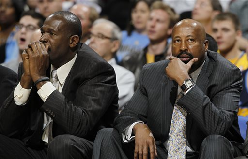 """In this March 13, 2013 file photo, New York Knicks head coach Mike Woodson, right, joins assistant coach Herb Williams in reacting as the Knicks fall behind to the Denver Nuggets in the third quarter of the Nuggets' 117-94 victory in an NBA basketball game in Denver. The Knicks have fired Woodson after falling from division champions to out of the playoffs in one season. New team president Phil Jackson made the decision Monday, April 21, 2014, saying in a statement """"the time has come for change throughout the franchise."""" (AP Photo/David Zalubowski, File)"""