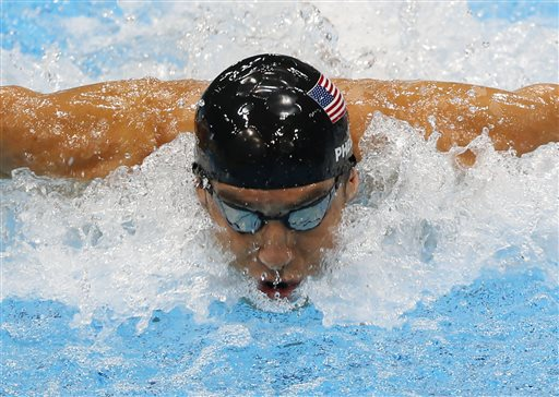 In this Aug. 4, 2012, file photo, United States' Michael Phelps swims in the men's 4 X 100-meter medley relay at the Aquatics Centre in the Olympic Park during the 2012 Summer Olympics in London. Phelps is coming out of retirement, the first step toward possibly swimming at the 2016 Rio Olympics. Bob Bowman, the swimmer's longtime coach, told The Associated Press on Monday, April 14, 2014, that Phelps is entered in three events — the 50- and 100-meter freestyles and the 100 butterfly at his first meet since the 2012 London Games at a meet in Mesa, Ariz., on April 24-26. (AP Photo/Julio Cortez, File)