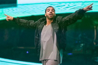 """In this Oct. 24, 2013 file photo, Drake performs during his """"Would You Like A Tour"""" show in Toronto. The Toronto-based rapper, singer and actor will host the July 16, 2014, ESPYs sports awards show on ESPN in Los Angeles. (AP Photo/The Canadian Press, Chris Young, file)"""