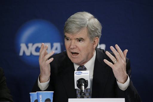 In this April 6, 2014 file photo, NCAA President Mark Emmert answers a question at a news conference in Arlington, Texas. The NCAA's board of directors is scheduled to discuss and endorse a 57-page overhaul plan that would hand far more power to five major conferences to decide how to treat and perhaps satisfy their athletes.(AP Photo/David J. Phillip, File)