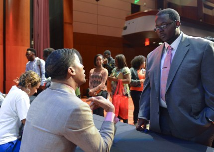 Ty'Quish Keyes, (right) a Buick Achievers Scholarship recipient, gets advice from Fonzworth Bentley, artist and pop culture icon during a celebrity meet and greet for a recent UNCF Empower Me Tour event in Atlanta, Ga. (Freddie Allen/NNPA)