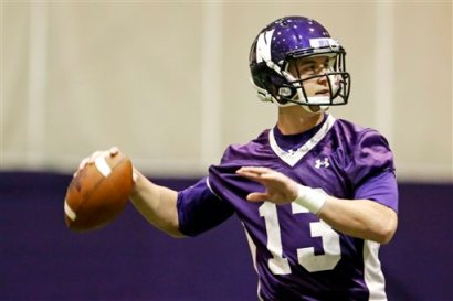 Northwestern quarterback Trevor Siemian throws as the football team participates in an NCAA college spring football practice Tuesday, April 1, 2014, in Evanston, Ill. After spring break, Northwestern resumed spring football practices with a huge issue that could change the college sports landscape hanging over their heads. A regional director of the National Labor Relations Board ruled last week that the team can bargain with the school as employees. (AP Photo/M. Spencer Green)